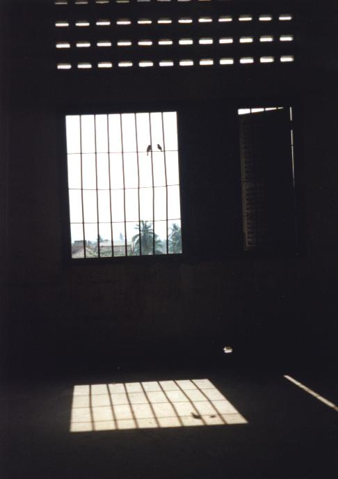 The barred windows of an upstairs detention cell