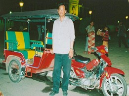 Vannak and his brand new tuk-tuk in 2006.